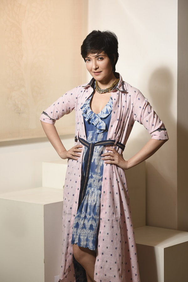 A Chanderi jacquard kurta shirt with tape detailing is paired with a linen Shibori dress with a ruffled neckline for a day-to-evening look. The pastel shades are perfect for a day look. Take off the shirt, add some accessories, like this choker from CIMA's costume jewellery section, and you are set for an evening do. (Dress: Rs 7,000, Kurta shirt: Rs 7,500, Choker: Rs 725)