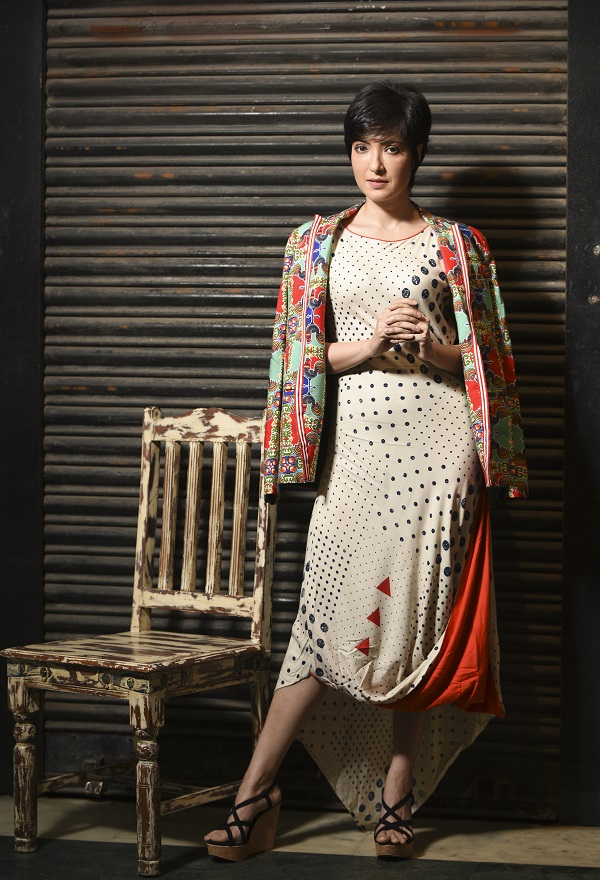 "Festive also means fun, and this geometric-print draped dress worn with a signature rooster-print lapel jacket from the men's section of Parole spells fun. (Dress: Rs 3,900, Jacket: Rs 9,000). ""Boyfriend jackets are in, so you can make a statement with the rooster-print jacket. The dress is casual. It is stretchy and comfortable. This outfit is great for a terrace party or even a staycation at a resort,"" said Dutta."