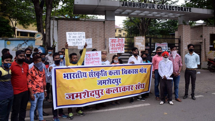 Artistes under the banner of Bhartiya Sanskriti Kala Vikas Manch protest outside the district collectorate on Thursday.