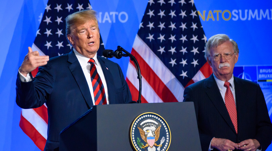 U.S. President Donald Trump, flanked by National Security Advisor John Bolton, speaks to the media at a press conference on the second day of the 2018 NATO Summit on July 12, 2018 in Brussels, Belgium.