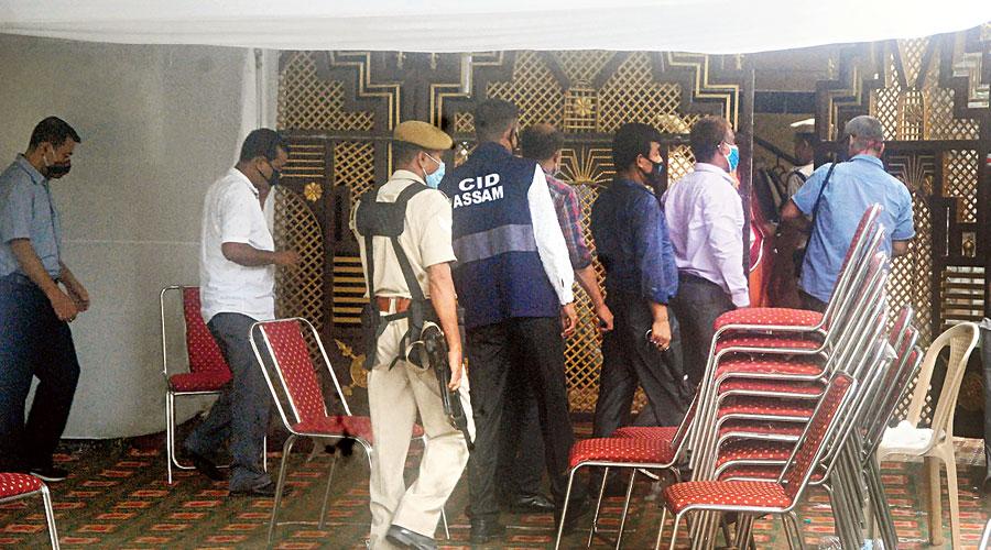 Investigators search the residence of former Assam DIG PK Dutta in Guwahati.
