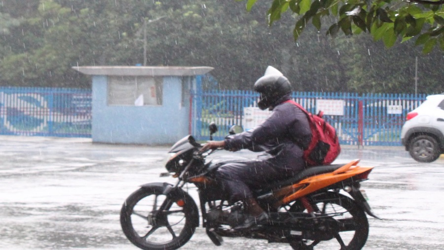A biker caught in the rain at Sakchi in Jamshedpur on Friday