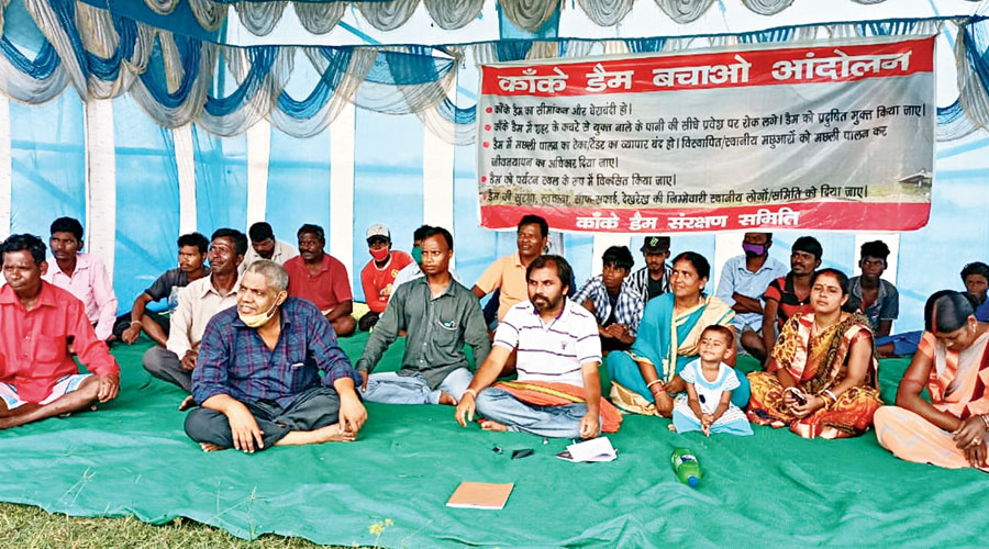 Amritesh Pathak (bearded in white striped T-shirt) with other residents at the indefinite satyagraha site near Kanke Dam in Ranchi on Friday.
