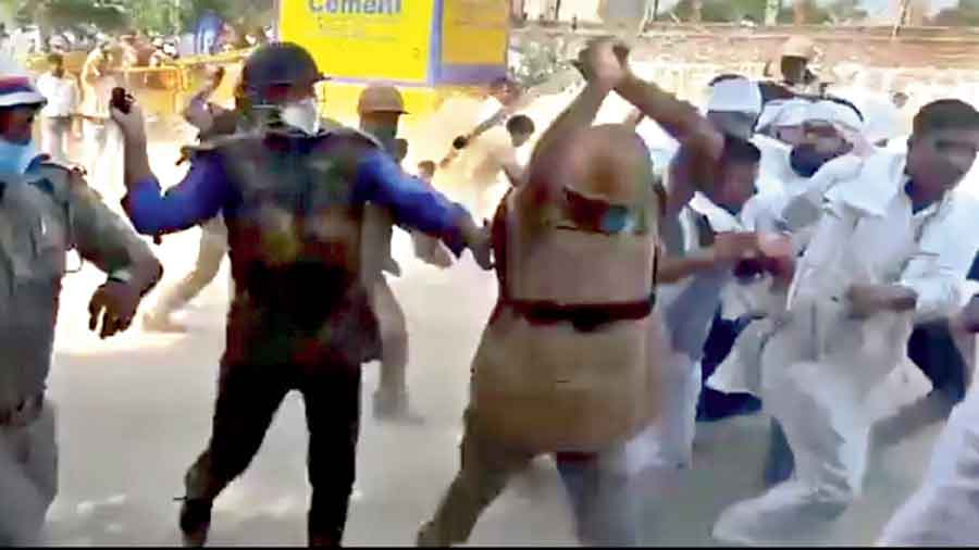 Several supporters could be seen taking lathi blows to protect Chaudhary