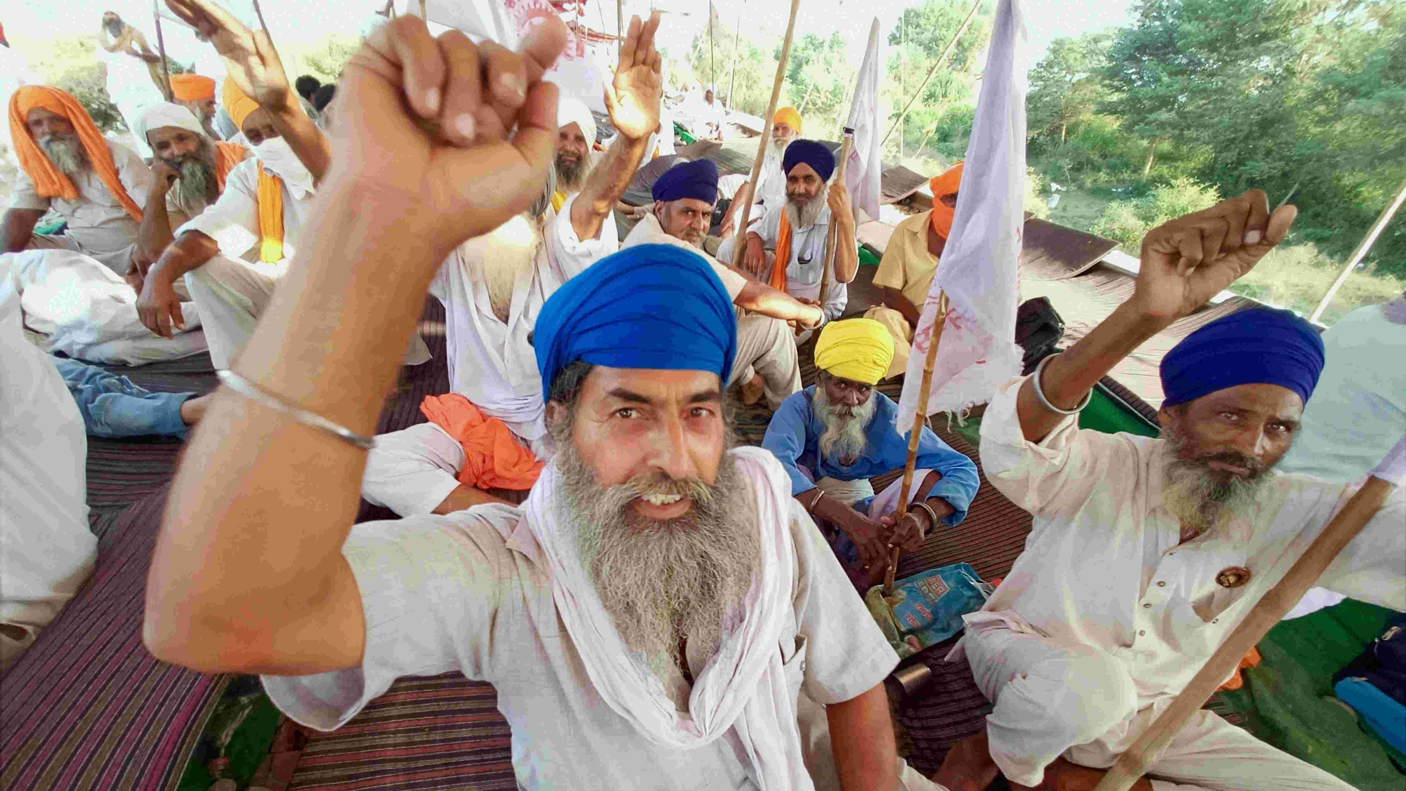 Farmers raise slogans during their ongoing Rail Roko or Stop the Trains agitation, against the central government over newly passed agri-bills, at Devi Dass Pura village, 20km from Amritsar, Tuesday, Sep. 29, 2020.