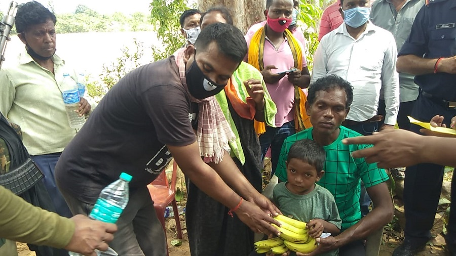 Villagers offer fruits to Wilson Madki after he was rescued on Monday.