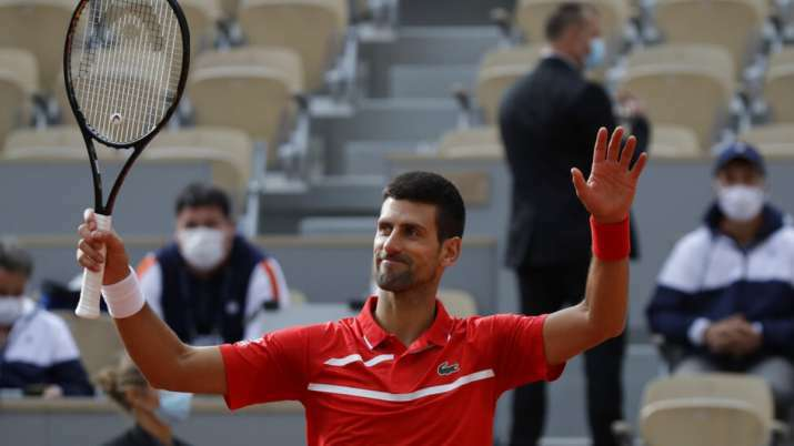 Novak Djokovic reaches record 11th consecutive quarterfinal at French Open.