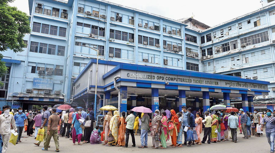 The queue outside and (right) inside the OPD at SSKM Hospital on Tuesday morning.