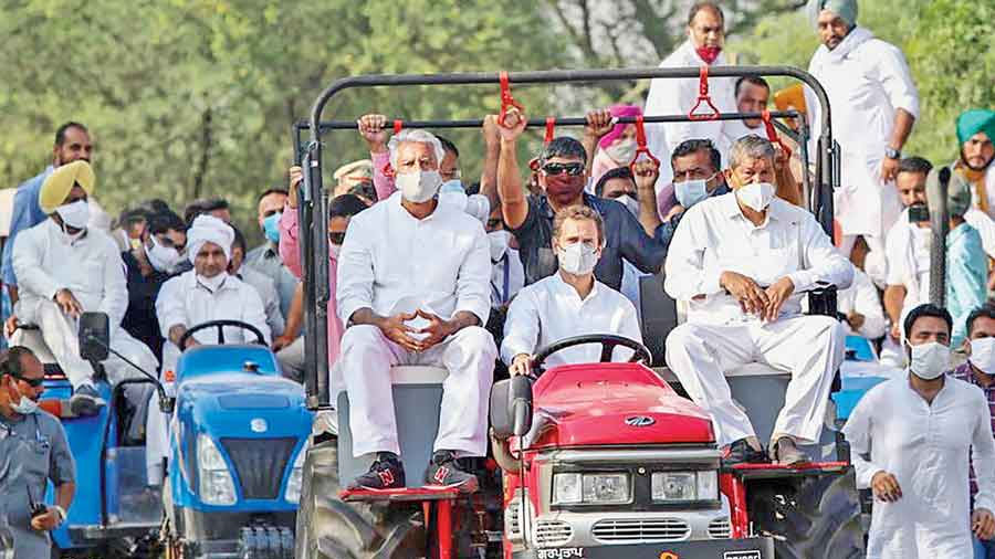 """Rahul Gandhi drives a tractor during a rally near the Punjab-Haryana border on Tuesday against the new farm laws.  The Haryana government allowed Rahul and other Congress leaders to enter the state after blocking them on the border for a while. As the cavalcade was halted, Rahul tweeted: """"They have stopped us on a bridge on the Haryana border. I'm not moving and am happy to wait here. 1 hour, 5 hours, 24 hours, 100 hours, 1000 hours or 5000 hours."""" The government changed its mind within an hour and lifted the blockade"""