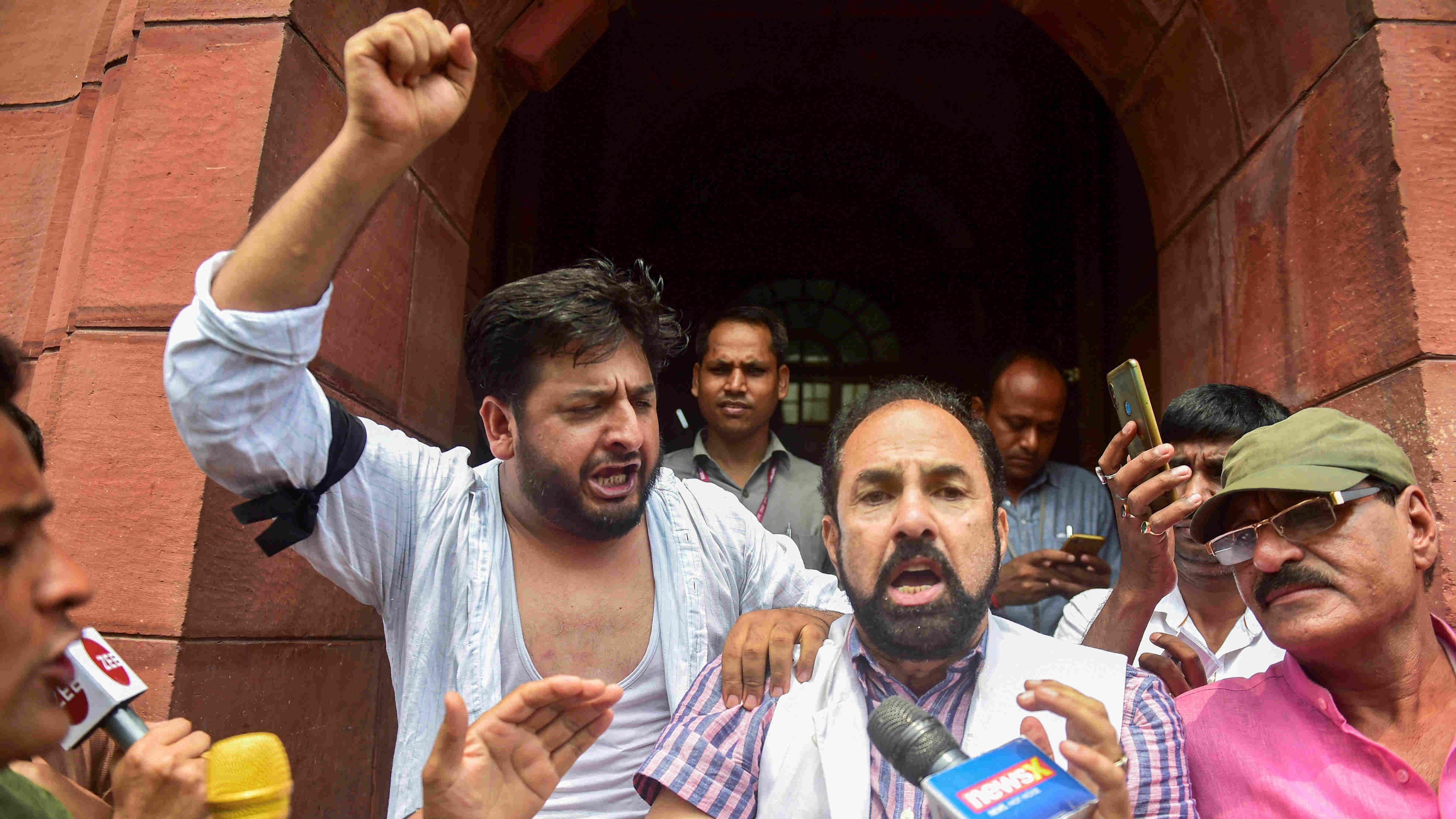 PDP MPs from Jammu and Kashmir, Fayaz Ahmad Mir and Nazir Ahmad Laway, shout slogans during a protest outside Parliament on August 5.