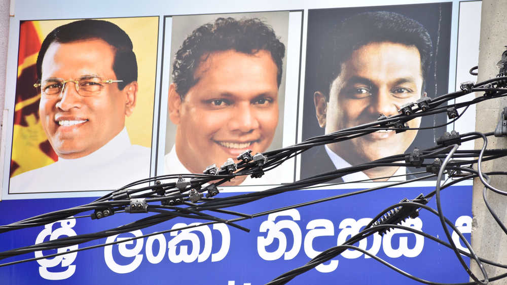 A political banner in Sri Lanka with former president Maithripala Sirisena and two politicians of the Sri Lanka Freedom Party, Dehiwala, Colombo.