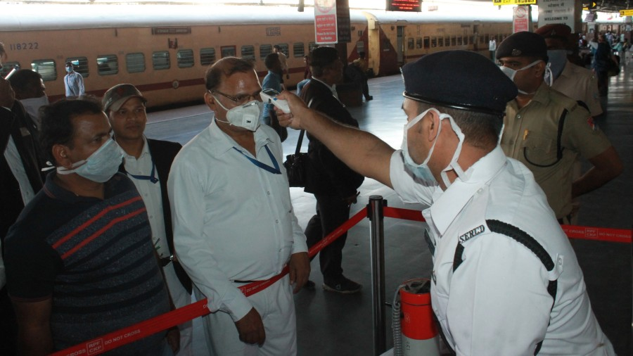 Thermal scanning of passengers at Tatanagar railway station.