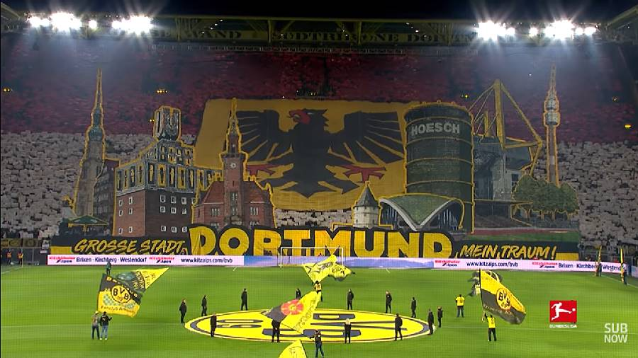 With huge banners and the city's coat of arms, Dortmund fans covered the entire Yellow Wall with a spinetingling display