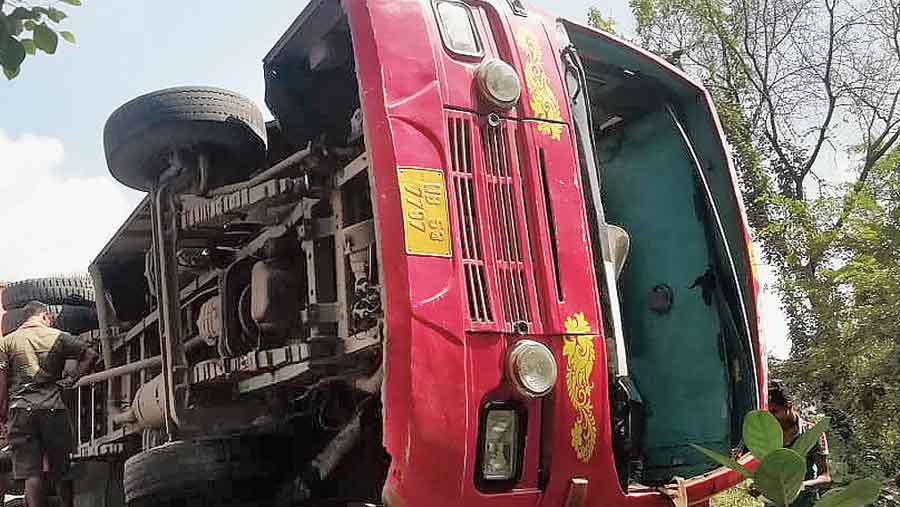 The private bus that toppled on one side near the Nakpur checkpost in Birbhum on NH14 on Saturday