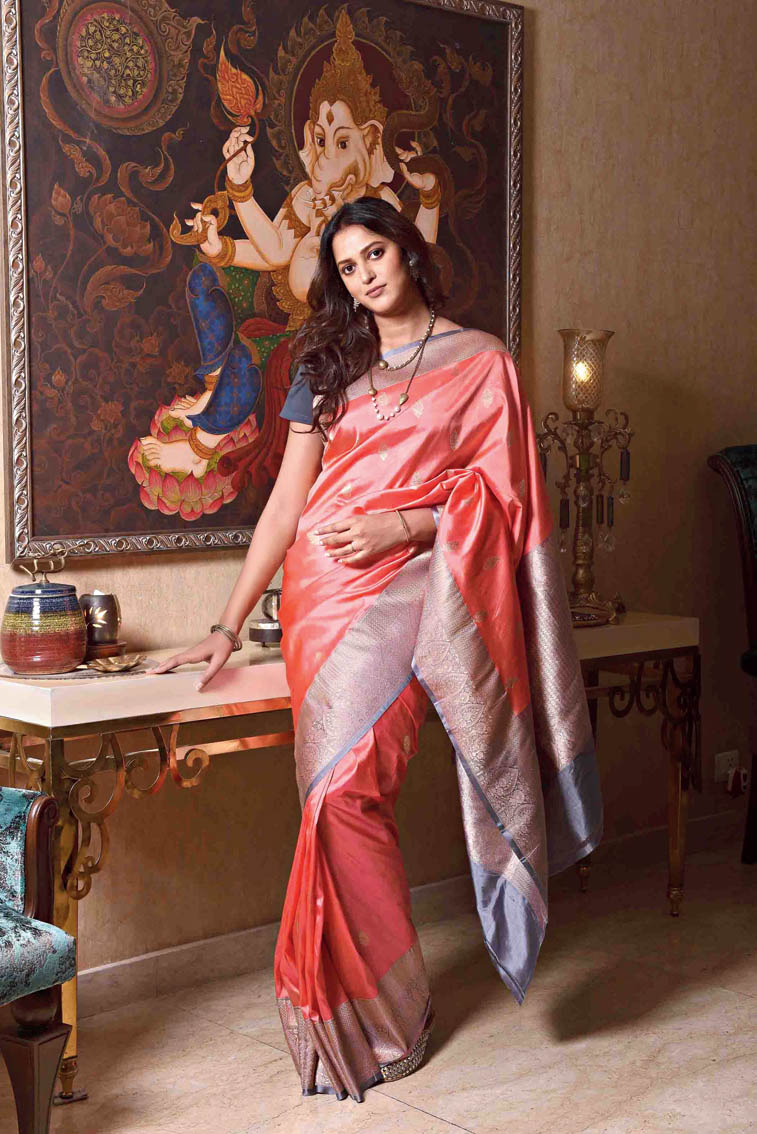 """2. Mitali looks straight out of a Raja Ravi Varma painting in this Benarasi katan silk. """"We wanted to do something different. We thought this was an unusual colour,"""" said Mitali. Brown eye-shadow, lots of mascara, brown eye pencil, brownish-peach lips and a soft toss of the hair made this look day to night."""