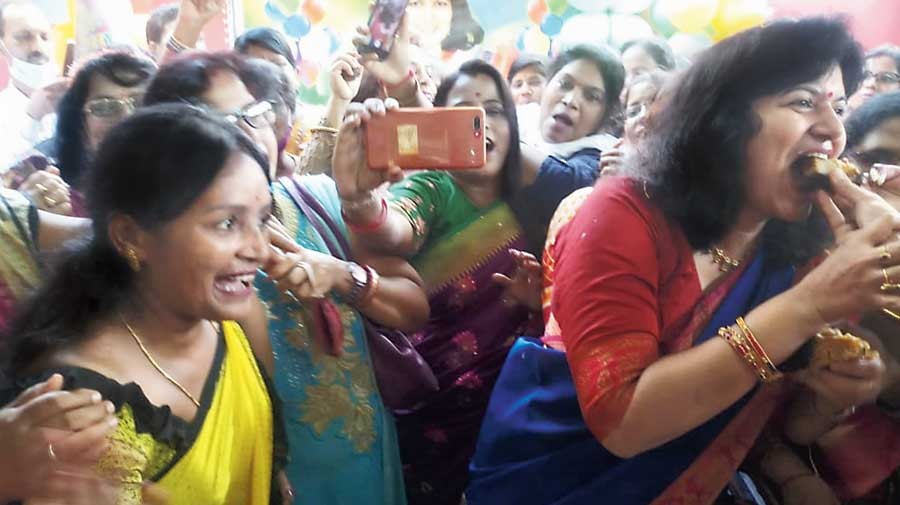 A supporter offering a slice of cake to Aparajita Sarangi (right) on the MP's birthday on Wednesday.