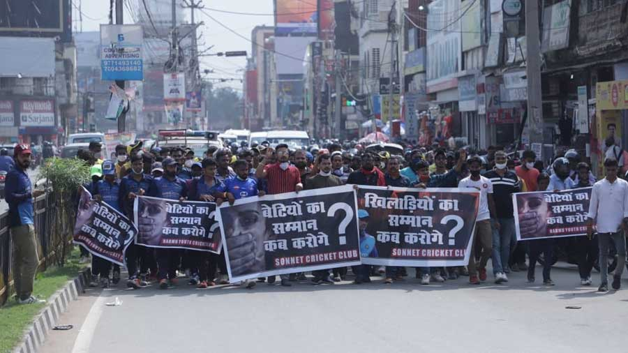 Cricketers walk in a march in Ranchi on Sunday protesting the incident.