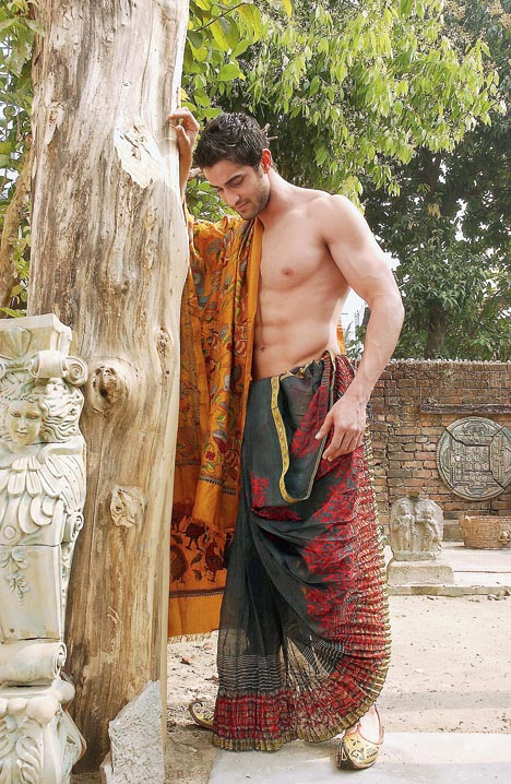 7. Neeraj Surana in a coloured dhoti by Sharbari