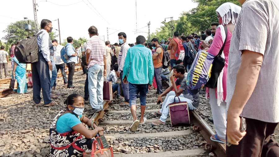 The rail blockade at Chinsurah on Monday. Those living in the suburbs and working in Calcutta have been facing the problem of reaching their workplace as local trains remained suspended to contain the spread of the novel coronavirus.