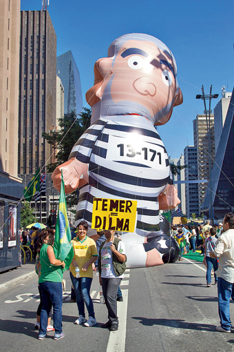 The protesters brought giant balloon cartoons of political leaders