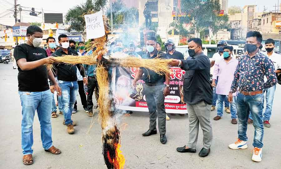 Jharkhand Christian Youth Association members burn an effigy to protest against the arrest of Stan Swamy at Albert Ekka Chowk  in Ranchi on Tuesday
