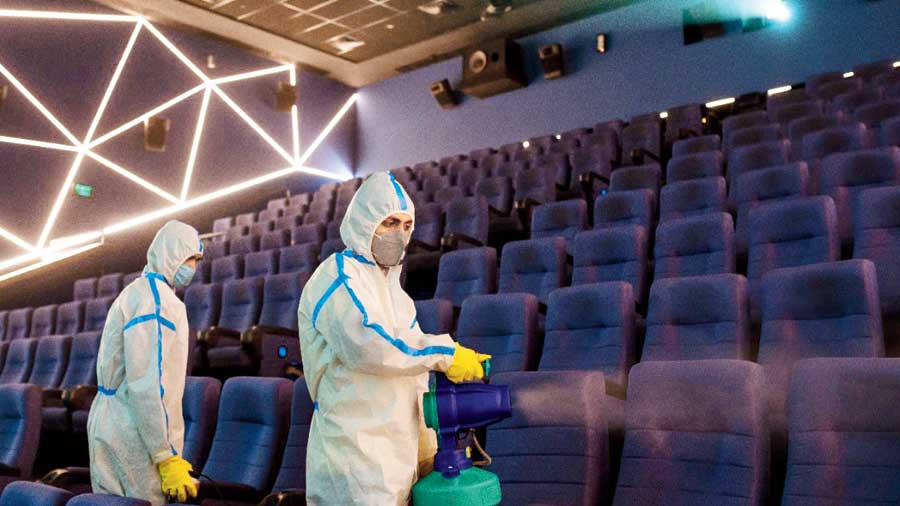 An INOX theatre in the city being sanitised on Tuesday