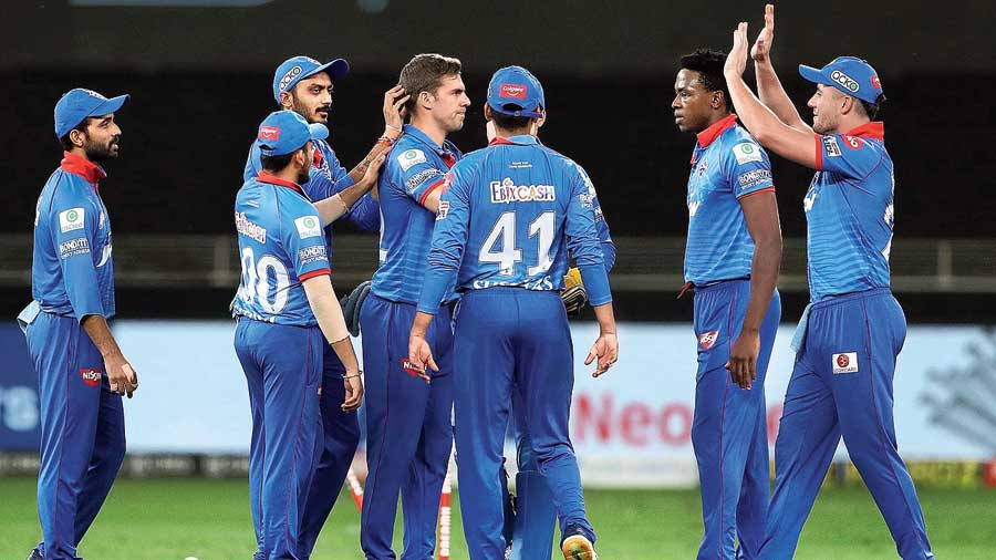 Anrich Nortje (centre) celebrates with his team after dismissing Jos Buttler  in Dubai on Wednesday.