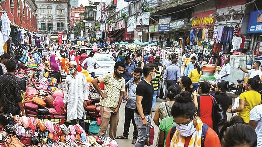 People shop at a market for the upcoming Durga Puja festival, in Kolkata, Tuesday, Sept 29, 2020.