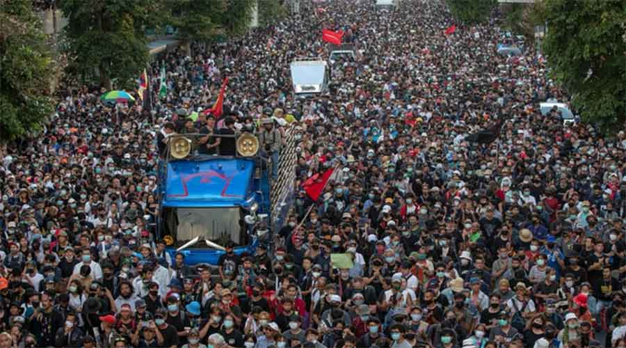 Protesters march towards Government House during an anti-government rally in Bangkok on Wednesday.