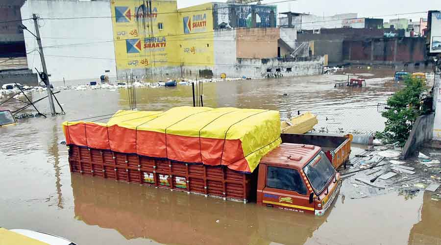 Vehicles submerged in floodwaters