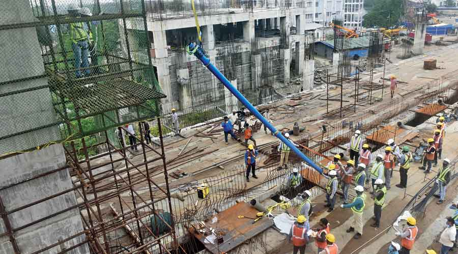 A cable (in blue sheath) being fixed for the new Majerhat bridge,