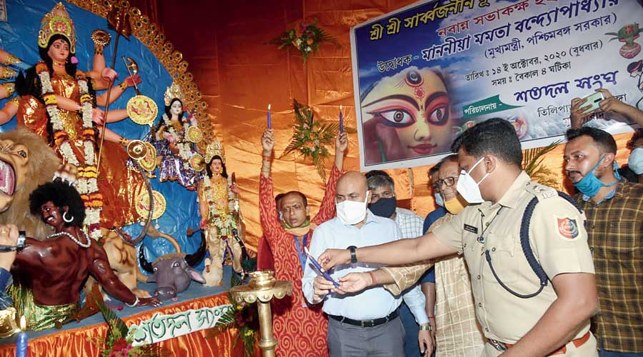 Senior officials at a Puja launched by the chief minister at Behrampore.