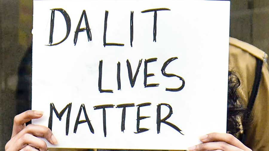A poster held aloft in Thane during a protest against Hathras atrocity.