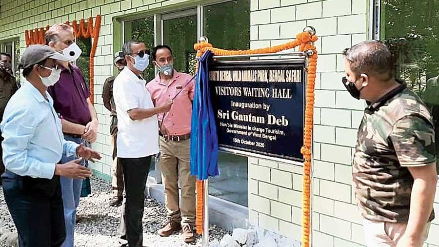 Deb inaugurates the waiting hall at the Bengal Safari Park.