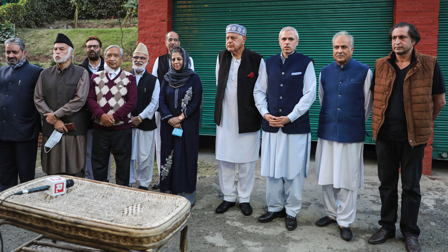 Jammu and Kashmir National Conference President Farooq Abdullah addresses a press conference along with his son Omar Abdullah, Peoples Democratic Party (PDP) President Mehbooba Mufti, Peoples Conference President Sajjad Gani Lone and others after meeting of signatories to the Gupkar declaration, at his residence in Srinagar, Thursday, Oct. 15, 2020.