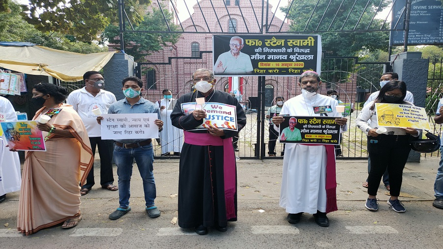 Archbishop Felix Toppo, Bishop Theodore Mascarenhas and others join a human chain to protest against the arrest of Stan Swami in Ranchi on Friday