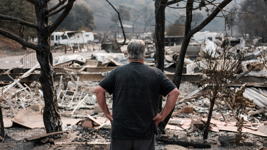 The  wildfires scorched more than 1.8 million acres in land, destroyed thousands of structures and caused at least three deaths