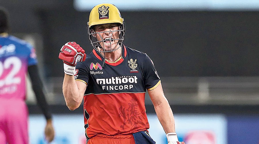 Man of the Match AB de Villiers exults after Royal Challengers Bangalore's 7-wicket win over Rajasthan Royals in Dubai on Saturday.