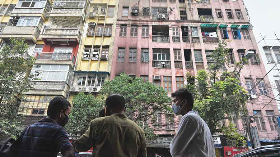 Moon House, (right, in pink) the seven-storey building at 21 Ganesh Chandra Avenue, where the fire had broken out on Friday night