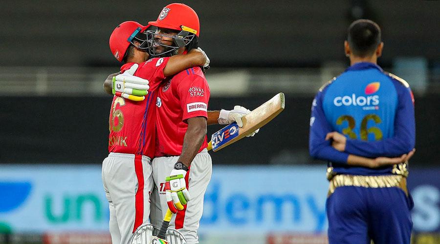 Kings XI Punjab players Mayank Agarwal and Chris Gayle celebrate after winning their IPL T20 cricket match against Mumbai Indians in Dubai on Sunday.