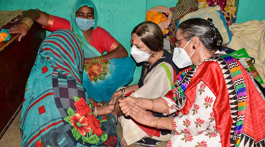 CPM politburo member Brinda Karat meets the family members of the 19-year-old woman in Hathras on Tuesday.