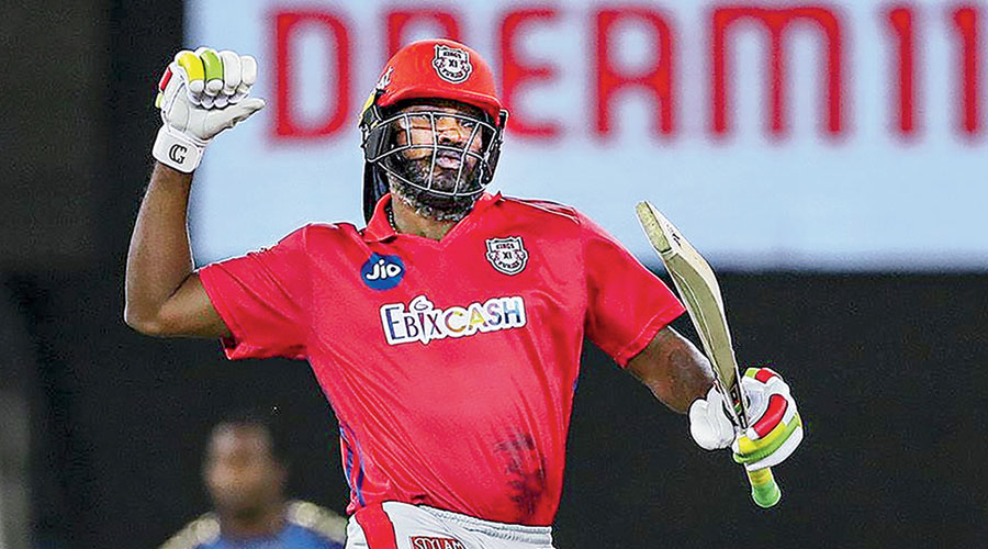 Kings XI Punjab's Chris Gayle celebrates after the win over Mumbai Indians following two Super Overs in Dubai on Sunday.