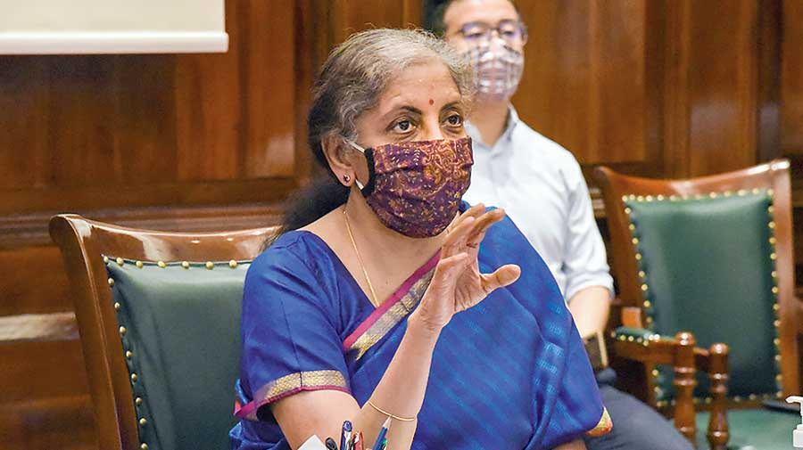 Nirmala Sitharaman attends a video conference  at North Block in New Delhi on Monday.
