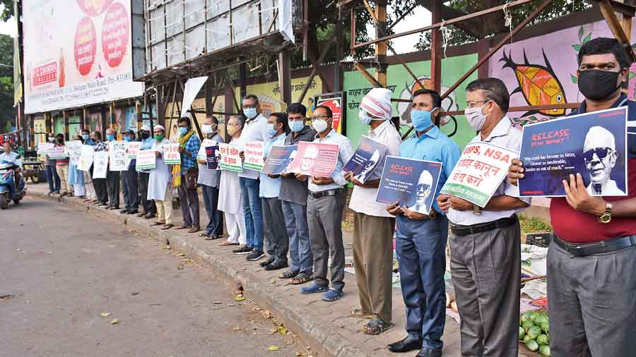 Members of rights organisations and activists form a human chain at Sakchi in Jamshedpur on Friday condemning the arrest of Father Stan Swamy