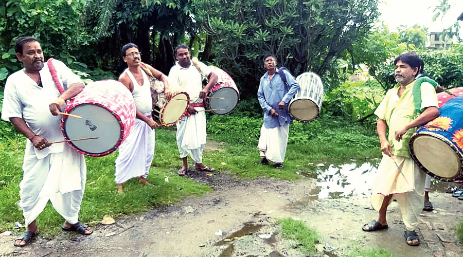 A group of traditional dhakis perform in East Burdwan's Kalna.
