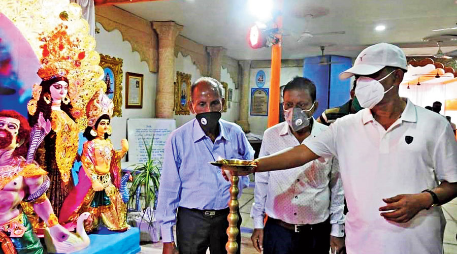 State tourism minister Gautam Deb (right) visits a Durga Puja pandal in Siliguri on Tuesday