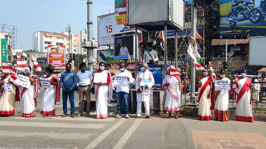 Tribals form a human chain to demand a Sarna code at Albert Ekka Chowk in Ranchi on Tuesday.