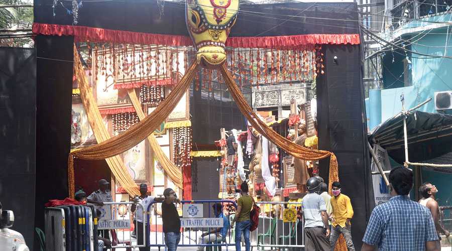 Barricades placed at the entrance to the Tridhara Sammilani puja pandal on Tuesday