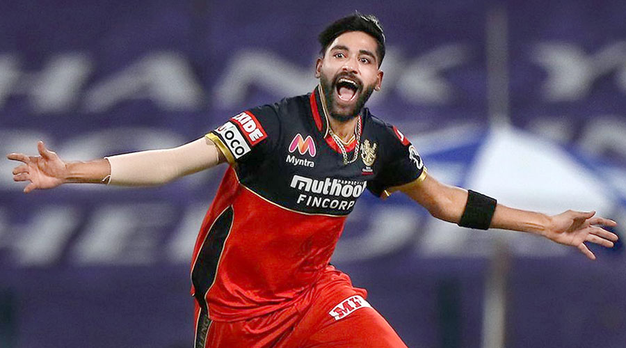 MoM Mohammed Siraj celebrates after taking the wicket of KKR's Nitish Rana in Abu Dhabi on Wednesday.