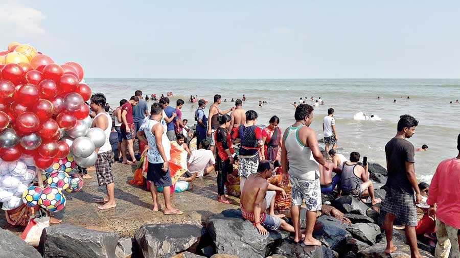 Tourists on the beach at Digha on Tuesday.